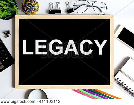 Legacy Concept On Drawing Board With Office Tools