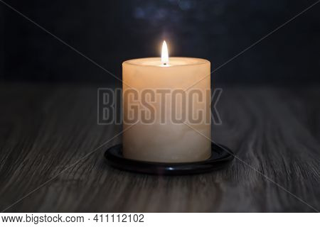 Candle On A Wooden Table. Death. Sympathy.