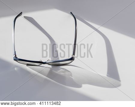 Top View Of Eyeglasses On White Background. Comfortable Life With Poor Eyesight. Ophthalmology. Cont