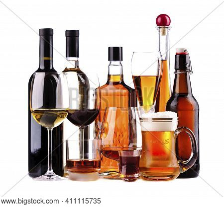 Alcohol. Glass With An Alcoholic Drink. Bottles Of Alcohol. Alcohol Addiction.