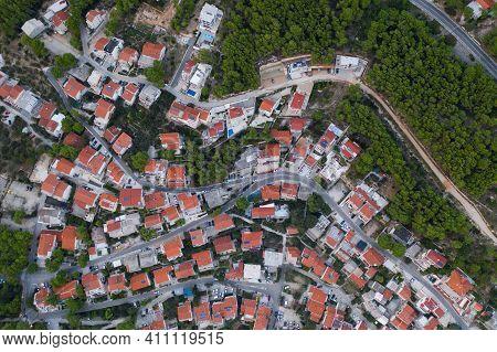 Aerial Top View On The Small Village Brela Situated In Croatia, Makarska Riviera. Beautiful Architec