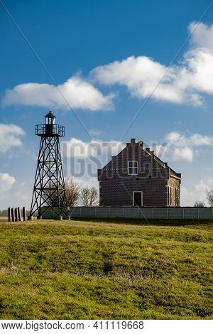 The Former Island Schokland. The Netherlands With Beautiful Spring Clouds And A Blue Sky, The Former