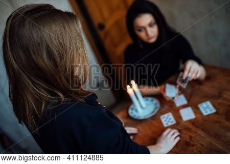 A Fortune Teller Predicts The Fate And Future Of A Girl On Tarot Cards