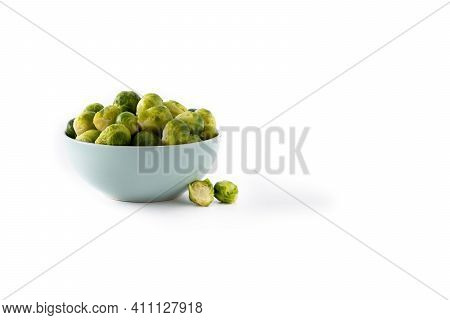 Set Of Brussel Sprouts In A Bowl Isolated On White Background. Copy Space