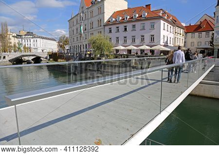 Ljubljana, Slovenia - October 12, 2014: New Glass Bridge Over River Ljubljanica For Pedestrians In L