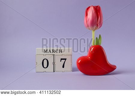 Calendar For March 7: A Cube With The Number 7, A Red Heart-a Vase With A Scarlet Tulip, The Name Of