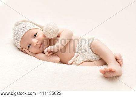 Cute baby sleeping on a moon shaped pillow