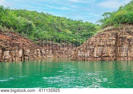 Landscape Of The Lake Of Furnas, Capitólio Mg, Brazil. Rock Walls Of On The Shore Of The Lake, Green