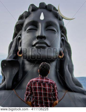 People Admiring Statue Of Lord Shiva In Rain. The Adi Yogi Statue Located In Isha Yoga Center , One