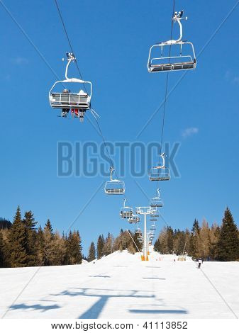 Skiers Riding Chairlift