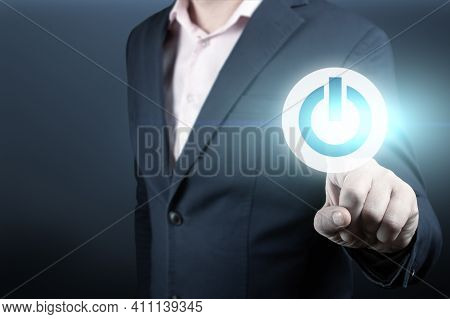 Businessman Presses The Start Button. Businessman Pressing Power Button Concept. Businessman Touchin