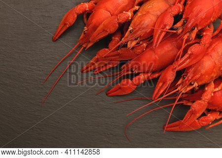 Cooked Red Crayfishes On Black Stone Background. Red Boiled Crayfishes Food. Shellfishes Delicious L