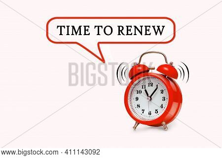 Time To Renew - Text On Light Pink Background With Red Alarm Clock
