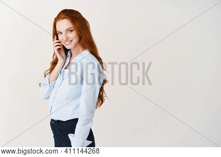 Beauty. Attractive Woman With Long Ginger Hair And Pale Skin Looking Tender At Camra, Touching Clean