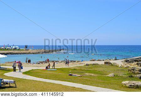 Paphos, Cyprus, Greece - June 5, 2018 : Tourists On Paphos Beach A Popular Tourist Resort In Cyprus