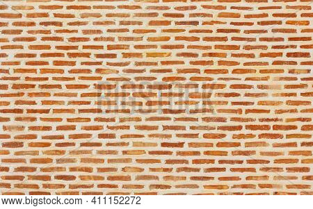 Beautiful brick wall texture with white cement joints, brick background