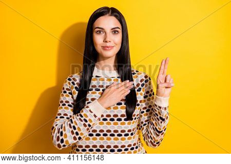 Photo Of Young Attractive Girl Confident Hand On Chest Swear Justice Honesty Isolated Over Yellow Co