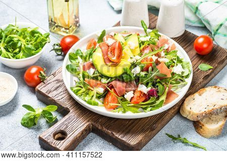 Green Salad With Avocado, Salad Leaves, Jamon Serrano And Tomatoes. Healthy Diet Lunch.
