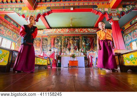 Rinchenpong, Sikkim, India - 17th October 2016 : Two Young Boy Lamas Standing Inside Prayer Room At