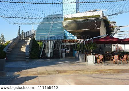 COSTA MESA, CA - DEC 1, 2017: Champagne French Bakery Cafe, South Coast Plaza and the stairs leading to the Bridge of Gardens pedestrian walkway connecting the two side of the mall.