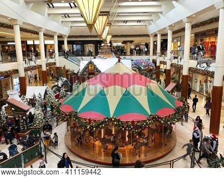COSTA MESA, CALIFORNIA - DEC 19, 2017: Carousel Court at South Coast Plaza with Santas Village  in the background.