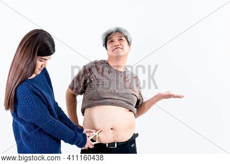 Asian Attractive Woman Using A Device To Measure The Size And Thickness Of Excess Fat On Skin Of  Ab