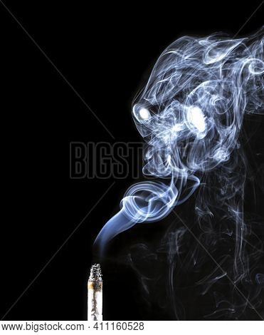 Portrait Of A Creepy Demon Made Of Smoke Coming From A Cigarette Against A Black Background. Creativ