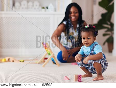Happy Toddler Baby Girl Playing Toys With Mother At Home