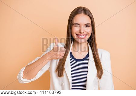 Photo Of Young Happy Positive Smiling Good Mood Girl Wink Eye Showing Thumb Up Isolated On Pastel Co