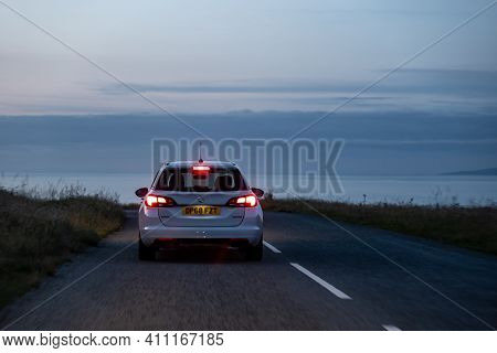 Scotland - August 5, 2019: Opel Vauxhall Astra Combi Ecotec Car On A Scottish Roads At Dusk With Bra