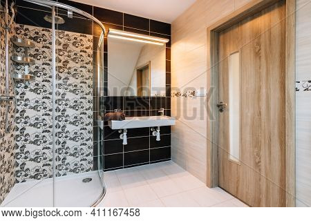 Beautiful Small Bathroom In Attic Of Family House.bathroom Has Large Glass Shower,double Basin With