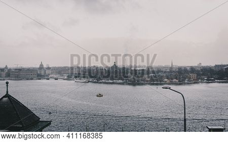 Winter Cityscape Of The Seaside Town (stockholm) With Heavy Snow And Fog, Which Underlines The Nordi