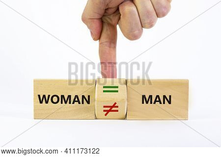 Symbol For Gender Equality. Businessman Turns A Cube And Changes A Unequal Sign To A Equal Sign Betw