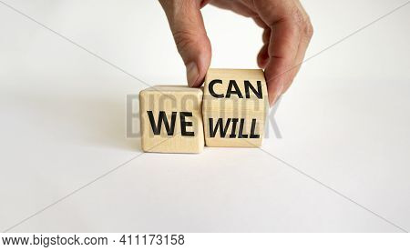 We Can And Will Symbol. Businessman Turns Cubes And Changes Words We Can To We Will. Beautiful White