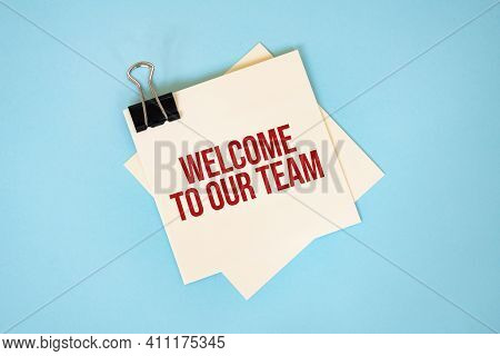 Text Welcome To Our Team On Sticky Notes With Copy Space And Paper Clip Isolated On Red Background.f