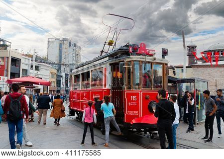 Istanbul, Turkey - October 6, 2019: Retro Red Tram In Taksim Square. Popular Tourist Tramway In Hist