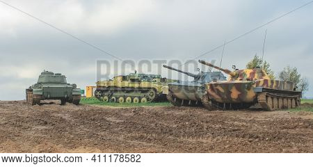 Minsk, Belaraus - October 2, 2012: Soviet T-34 And Pt-76 Tanks In Good Technical Condition In The Be