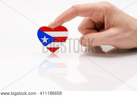 Puerto Rico Flag. Love And Respect Puerto Rico. A Man's Hand Holds A Heart In The Shape Of The Puert