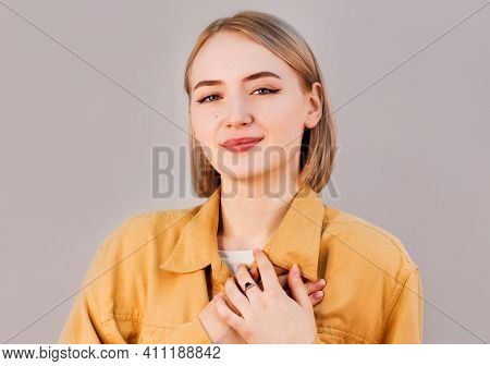 Faithful Woman Keeps Hands On Chest Near Heart, Shows Her Kindness Or Favour, Expresses Sincere Emot