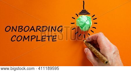 Onboarding Complete Symbol. Businessman Writing Words 'onboarding Complete', Isolated On Beautiful O
