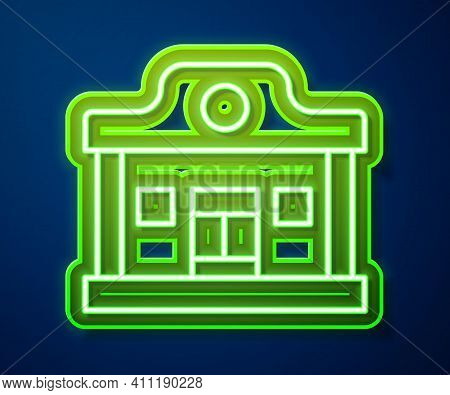 Glowing Neon Line Wild West Saloon Icon Isolated On Blue Background. Old West Building. Vector