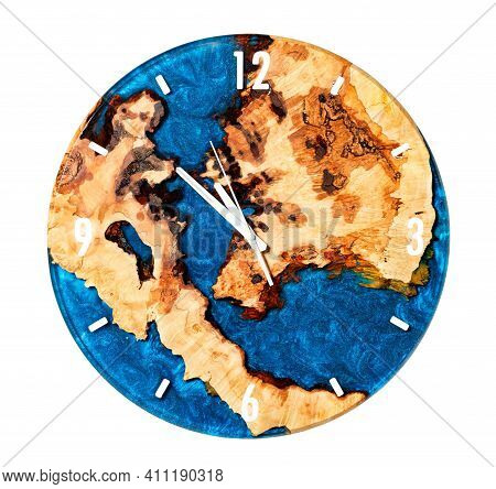 Beautiful Round Wooden Wall Clock Made Of Cut Tree Roots And Translucent Epoxy Resin In Blue On The