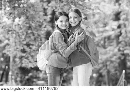 Girls Backpackers Friends Fleece Clothes Backpacks Forest Background, Travel Together Concept.