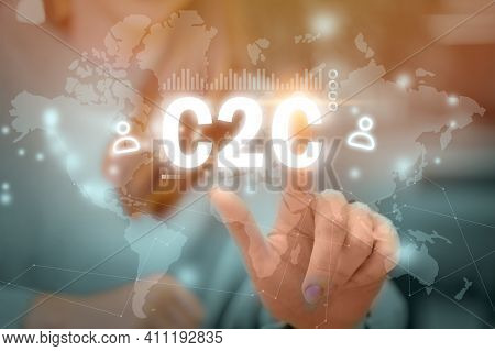 C2c Concept. Person Presses Consumer To Consumer On Abstract Graphic Display With World Map.