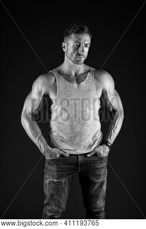 Stay Strong. Strong Man In Casual Style Black Background. Building Biceps And Triceps. Muscle Workou