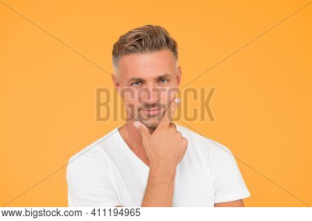 Ask Barber To Shave. Serious Man Touch Beard Hair Yellow Background. Handsome Guy With Unshaven Face