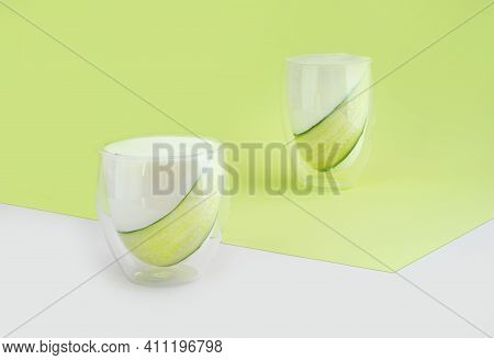 Probiotic Drink, Buttermilk Or Yogurt. Kefir And Cucumber In Glass On Minimalistic Isometric Diagona