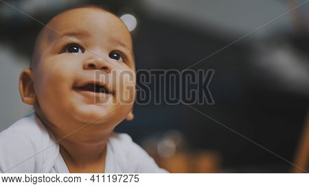 Portrait Of Adorable African American Black Baby With Funny Face Expression. High Quality Photo