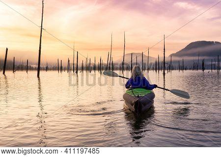 Adventurous Girl Kayaking On An Infatable Kayak In A Beautiful Lake. Colorful Peaceful Sunrise Art R