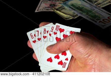 Poker Cards With A Straight Flush Combination. Close Up Of A Gambler Hand Is Holding Playing Cards I